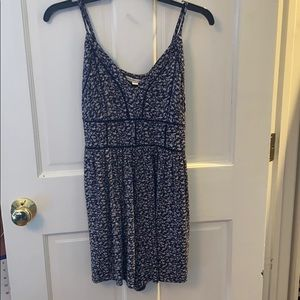 Navy blue and white floral romper